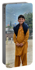 Portable Battery Charger featuring the photograph Happy Laughing Pathan Boy In Swat Valley Pakistan by Imran Ahmed