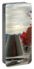 Portable Battery Charger featuring the photograph Harborside Fountain Park by E Faithe Lester