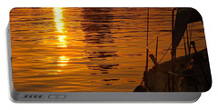 Portable Battery Charger featuring the photograph Harbour Sunset by Clare Bevan