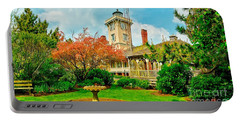 Hereford Inlet Lighthouse Garden Portable Battery Charger by Nick Zelinsky
