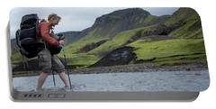 Hiker Crossing A River Portable Battery Charger