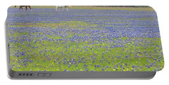 Horses Running In Field Of Bluebonnets Portable Battery Charger