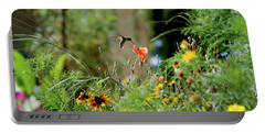Portable Battery Charger featuring the photograph Humming Bird by Thomas Woolworth