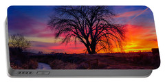 Portable Battery Charger featuring the photograph Idaho Winter Sunset by Greg Norrell