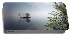 In The Distance On Mille Lacs Lake In Garrison Minnesota Portable Battery Charger
