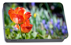 Portable Battery Charger featuring the photograph In The Garden by Kerri Farley