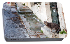 Portable Battery Charger featuring the photograph In The Streets Of Athens by Laura Melis