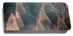 Portable Battery Charger featuring the photograph Incense Coils by Lucinda Walter