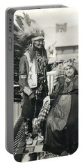 Portable Battery Charger featuring the photograph Indian Chief And Woman by Charles Beeler