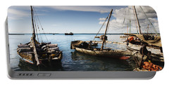 Portable Battery Charger featuring the photograph Indian Ocean Dhow At Stone Town Port by Amyn Nasser