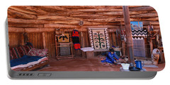 Inside A Navajo Home Portable Battery Charger by Diane Bohna