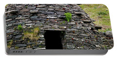 Portable Battery Charger featuring the photograph Irish Beehive House by Patricia Griffin Brett