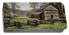 Portable Battery Charger featuring the photograph John Oliver's Cabin In Spring. by Debbie Green