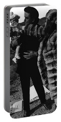 Portable Battery Charger featuring the photograph Johnny Cash Flesh And Blood Music Homage Cash Family Old Tucson Az by David Lee Guss
