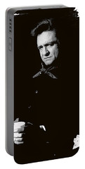 Portable Battery Charger featuring the photograph Johnny Cash Sitting With Cup  Old Tucson Arizona 1971-2009 by David Lee Guss