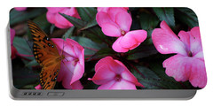 Portable Battery Charger featuring the photograph Just A Small Taste For This Butterfly by Thomas Woolworth