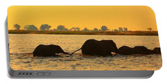 Portable Battery Charger featuring the photograph Kalahari Elephants Crossing Chobe River by Amanda Stadther