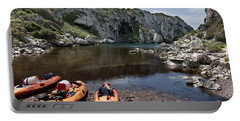 Kayak Time - The Landscape Of Cales Coves Menorca Is A Great Place For Peace And Sport Portable Battery Charger by Pedro Cardona