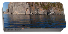 Portable Battery Charger featuring the photograph Kayaking Beneath The Light by James Peterson