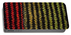 Portable Battery Charger featuring the photograph Knitted Striped Scarf by Les Palenik
