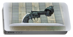 Knotted Gun Sculpture At The United Nations Portable Battery Charger
