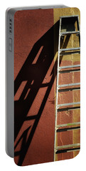 Ladder And Shadow On The Wall Portable Battery Charger by Gary Slawsky