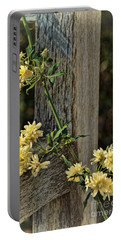 Portable Battery Charger featuring the photograph Lady Banks Rose by Peggy Hughes