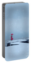Lady In Red On Snowy Pier Portable Battery Charger