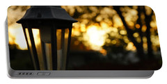 Portable Battery Charger featuring the photograph Lamplight by Photographic Arts And Design Studio