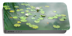 Portable Battery Charger featuring the photograph Lilly Pads by Erika Weber