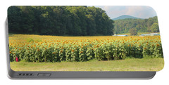 Little Girl And Big Sunflowers Portable Battery Charger