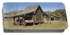 Portable Battery Charger featuring the photograph Log Cabin And Barn by Charles Beeler
