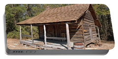 Portable Battery Charger featuring the photograph Log Cabin by Charles Beeler