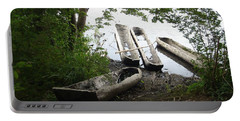 Portable Battery Charger featuring the photograph Log Canoes by Kerri Mortenson