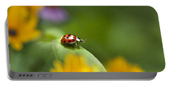 Portable Battery Charger featuring the photograph Lonely Ladybug by Christina Rollo