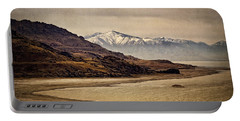 Portable Battery Charger featuring the photograph Lonesome Land by Priscilla Burgers