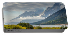 Low Clouds On The Teton Mountains Portable Battery Charger by Debra Martz
