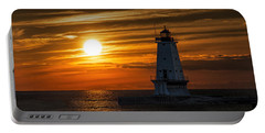 Ludington Pier Lighthead At Sunset Portable Battery Charger by Randall Nyhof