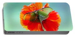Luna Moth On Poppy Aqua Back Ground Portable Battery Charger by Randall Branham