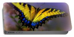 Portable Battery Charger featuring the photograph Magic Of Flight by Karen Wiles