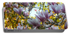 Portable Battery Charger featuring the photograph Magnolia Maidens In A Border by Leanne Seymour