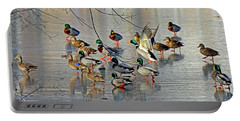 Mallards On A Frozen River Portable Battery Charger by Rodney Campbell