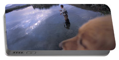 Man And Dog Fly Fishing On Silver Portable Battery Charger