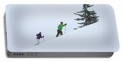 Man And Woman Snowshoeing Up Slope Portable Battery Charger