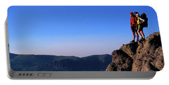 Man And Woman Standing Ontop Of Cliff Portable Battery Charger
