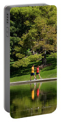 Man And Woman Walking In Park, Salt Portable Battery Charger