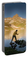 Man Fishing In Ice Lake Portable Battery Charger