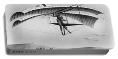 Man Gliding In 1883 Portable Battery Charger