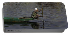 Man Plying A Wooden Boat On The Dal Lake Portable Battery Charger