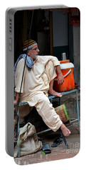 Man Sits And Relaxes In Lahore Walled City Pakistan Portable Battery Charger